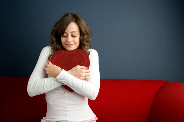 woman-hugging-box-of-chocolates